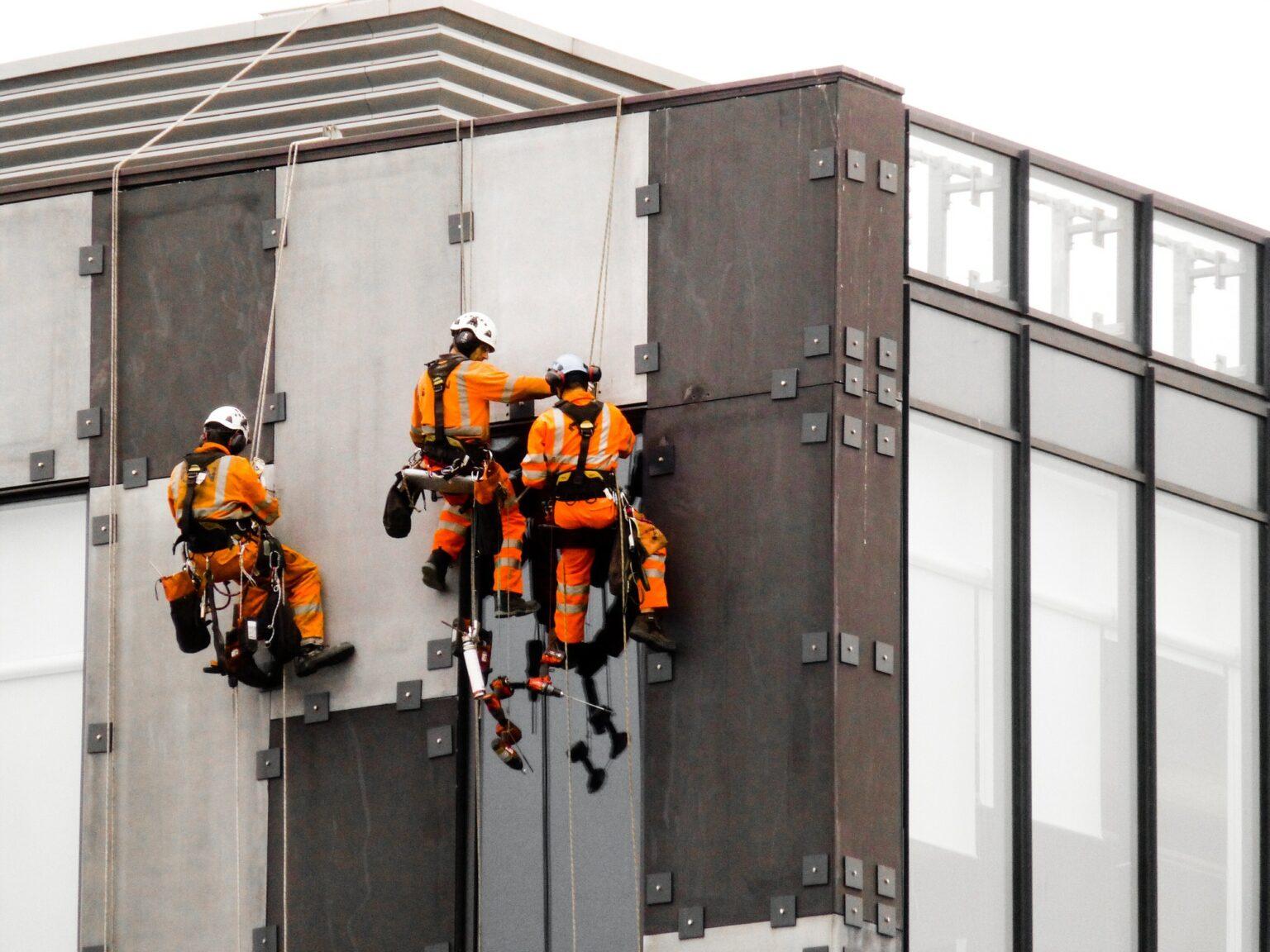 Three workmen working safely
